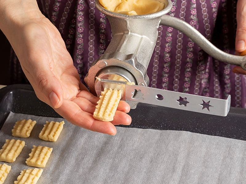 Cookies Pressing Dough Through