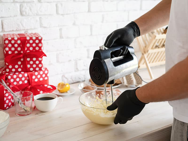 Hands Mixing Bisquick Dough Electric
