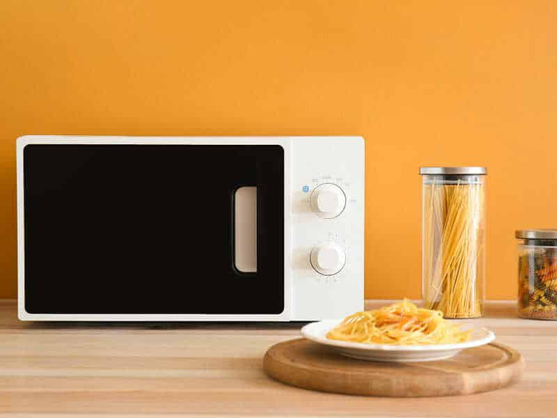 Modern compact microwave oven in kitchen
